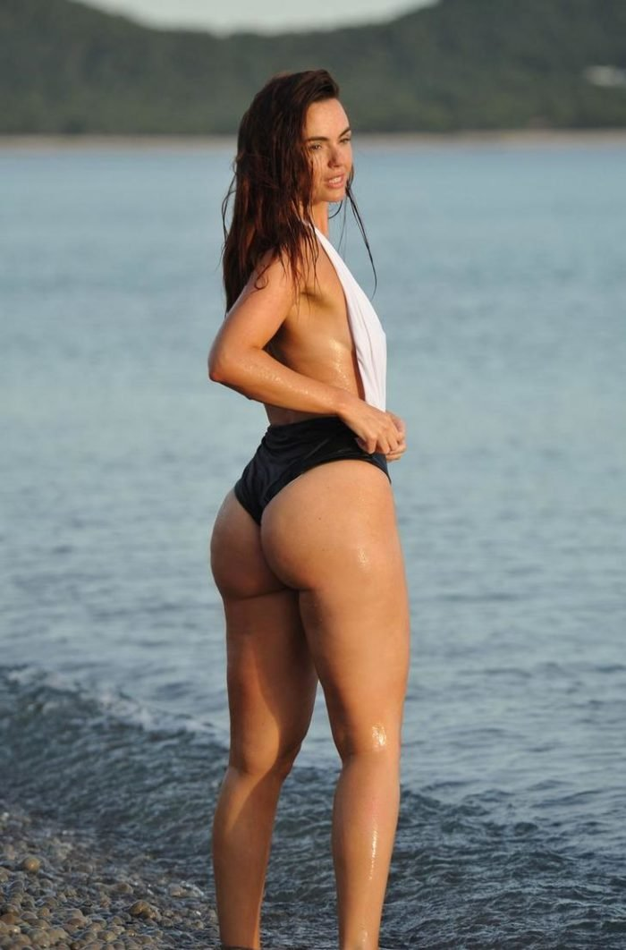Jennifer Metcalfe at the beach modeling in a swimsuit