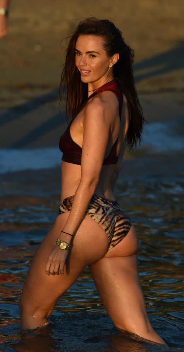 Jennifer Metcalfe in a bikini with a gold watch