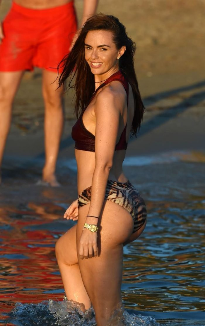 Jennifer Metcalfe in leopard bottom and maroon top swimwear