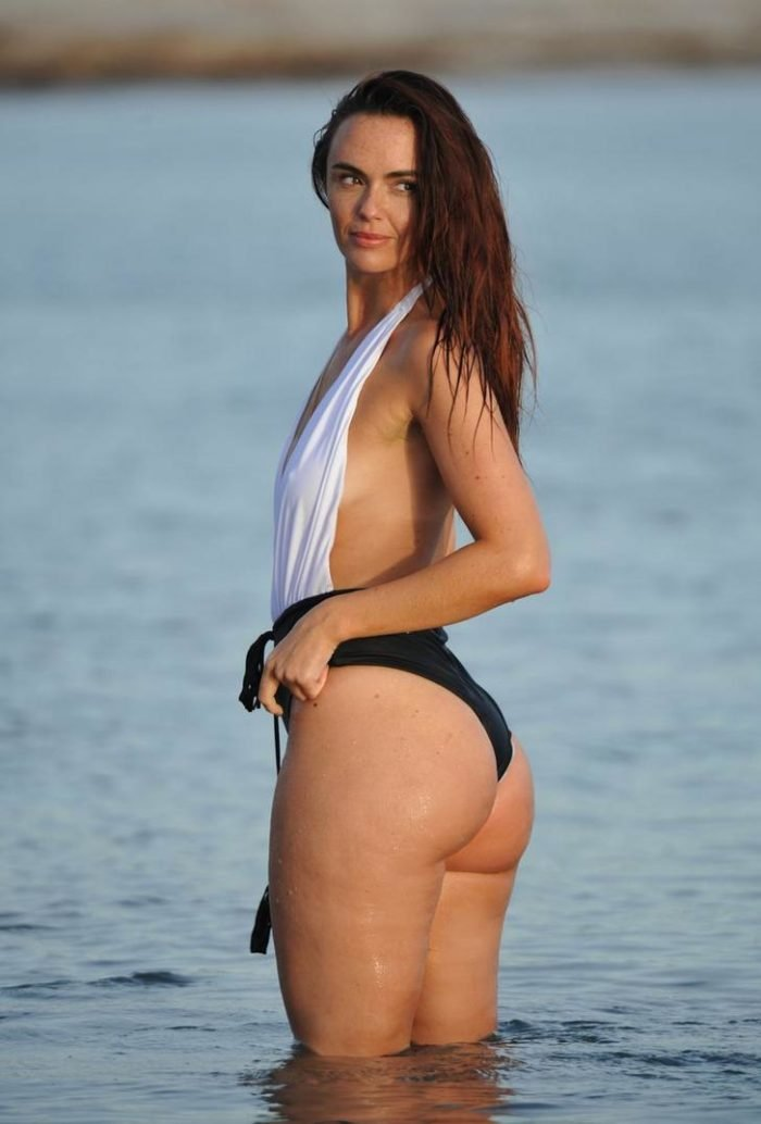 Jennifer Metcalfe showing off her nice booty in black and white one piece
