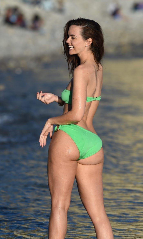 Jennifer in Ibizia in a green bikini in the water