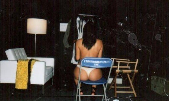 Kim Kardashian's leaked pic in dressing room sitting on a chair with ass cheeks visible