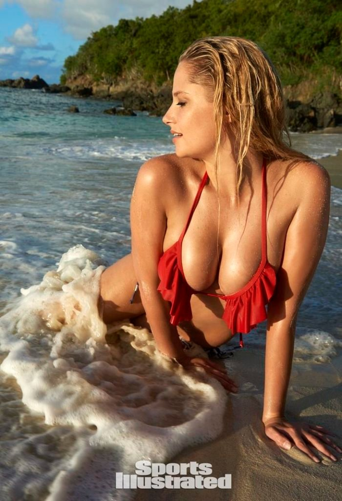 Sports Illustrated Genevieve Morton on the beach laying in the sand