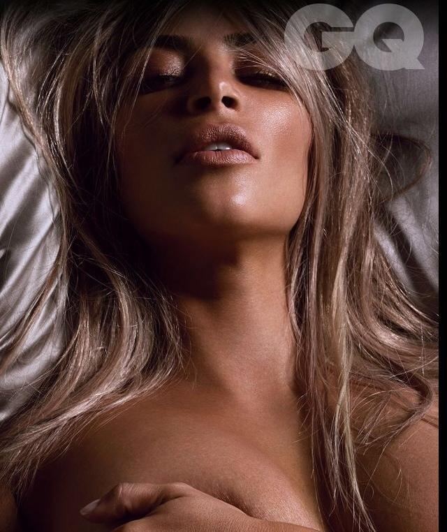 Up close pic of Kim Kardashian grabbing her boob