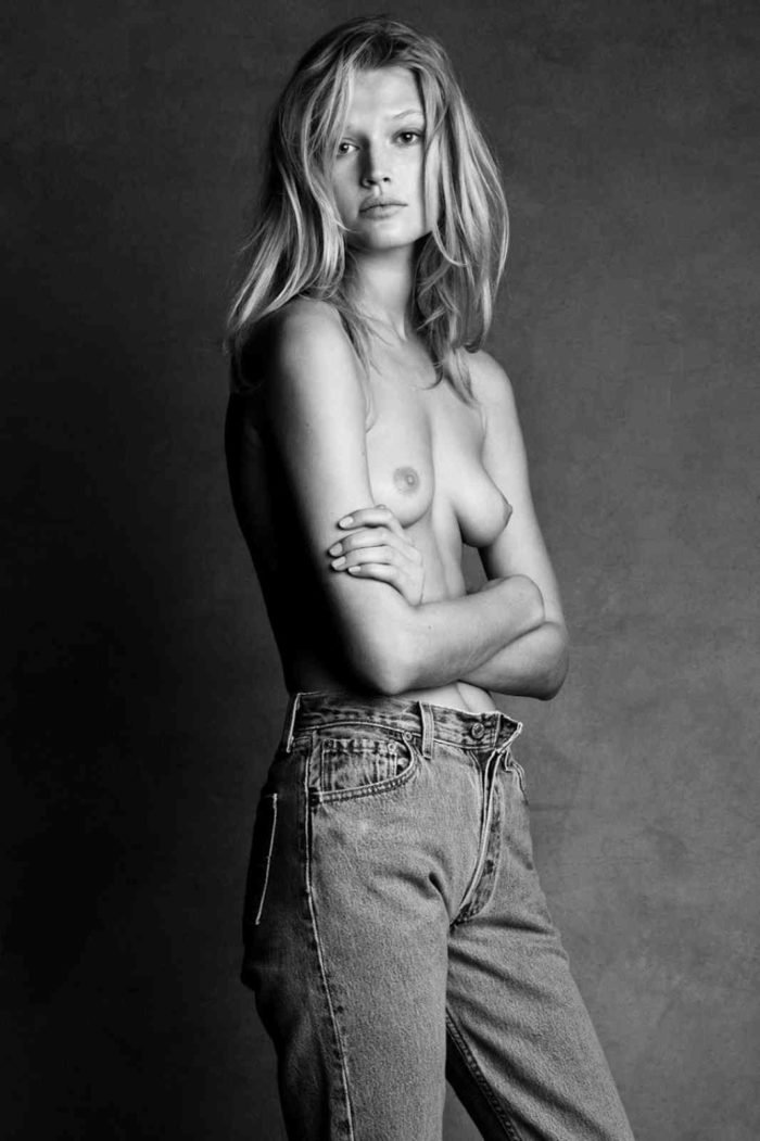 Toni Garn modeling without a bra on in black and white photo