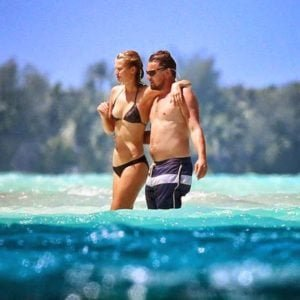 Toni Garrn and Leo at the beach in bathing suits